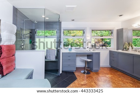 Remodel of light and airy master bathroom with custom tiled shower and cork flooring completed - stock photo