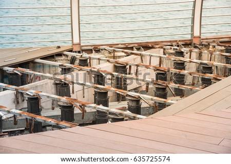 Remodel of timber boardwalk wooden walkway on shore of singapore sea slope adjustable
