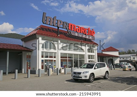 REMOLLON, FRANCE - SEPTEMBER 8, 2014: Intermarche is a French supermarket brand, part of the large retail group Les Mousquetaires founded in 1969 by Jean Pierre Roch - stock photo