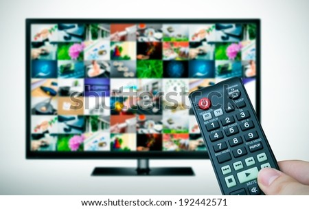 Remote and TV with multiple images gallery - stock photo