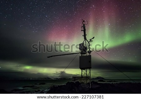 Remote Automated Weather Station - Arctic, Spitsbergen - Northern Lights - stock photo