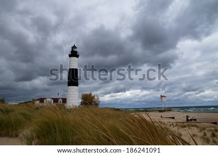 Remote Big Sable Point Lighthouse is only accessible by foot. Located in Ludington State Park, it has stood watch over the Lake Michigan shoreline for over a century. Ludington State Park, Michigan.  - stock photo