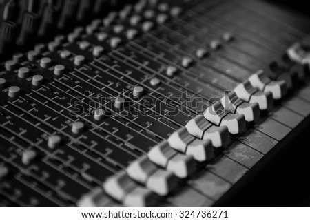 Remote control for audio recording . Mixing console for audio recording  - stock photo