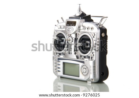 Remote control for helicopers and airplanes isolated on white - stock photo