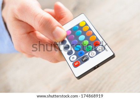 Remote control for led lighting, concept of chromotherapy - stock photo