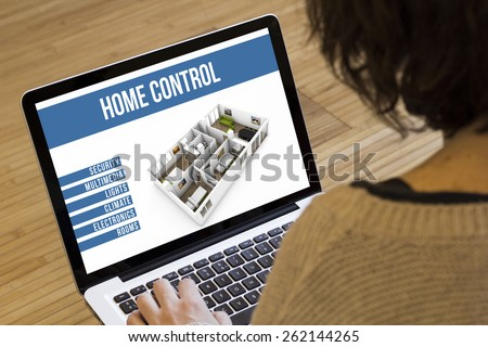 remote control home automation online concept: smart home remote control software on a laptop screen - stock photo