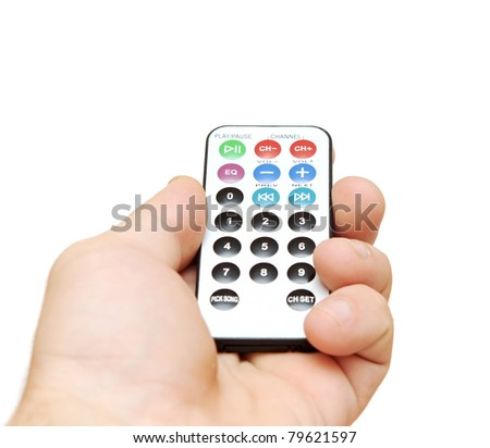Remote control in hand on white - stock photo