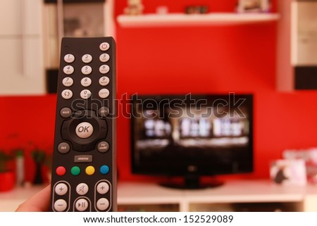 Remote control in living room. - stock photo