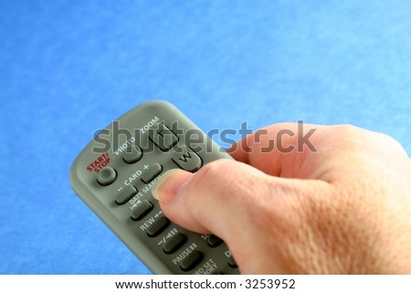 Remote control on blue