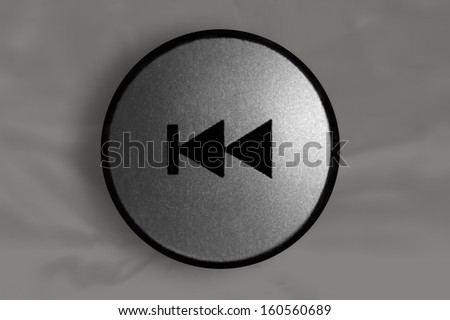 Remote control rewind button. - stock photo