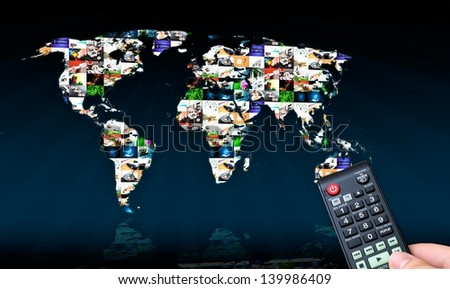 Remote control with virtual multimedia screen in background. World map composition - stock photo