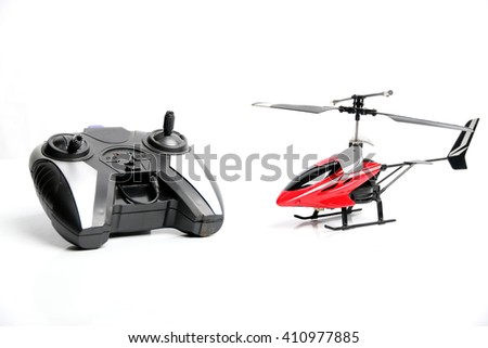 Remote controlled helicopter with controlling handset, isolated on white background - stock photo