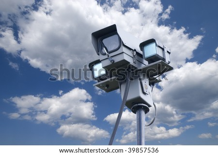 Remote controlled security camera with cloudy blue sky - stock photo