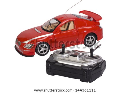 Remote controlled toy car with a game controller - stock photo