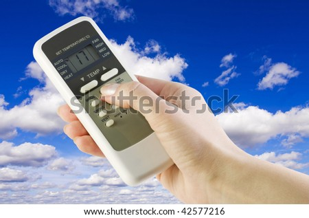 remote from the conditioner in the women's arm against the sky