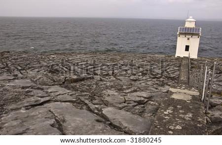 remote lighthouse on west coast of ireland - stock photo