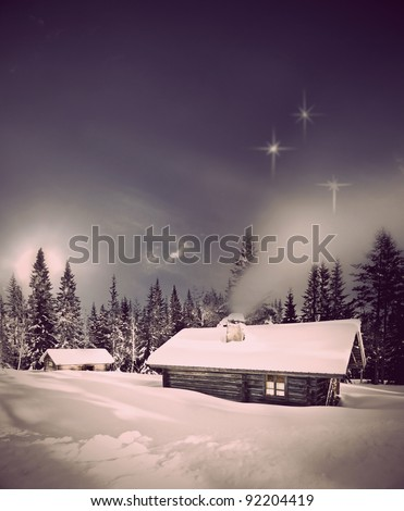 Remote log cabin in winter evening with stars in sky - stock photo