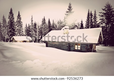 Remote log cabin in winter with vintage look - stock photo