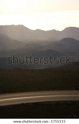 Remote road at summit of Haleakala Volcano, Maui, Hawaii - stock photo