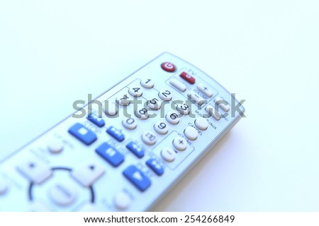 remote tv control access isolated on a white background - stock photo