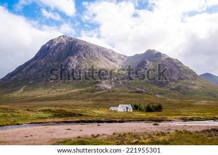 remote white cottage at glencoe, scotland - stock photo