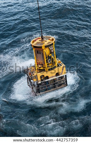 Remotly operated vehicle entering the water - stock photo