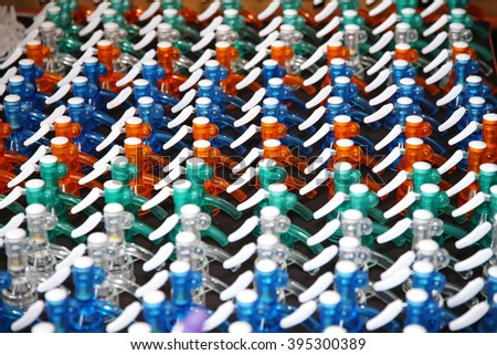 Removable plastic caps for soda water siphon bottles for sale on market. - stock photo