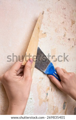 removal of old wallpapers with spatula  - stock photo