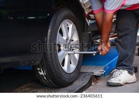Remove/ Install Wheel Nut. - stock photo
