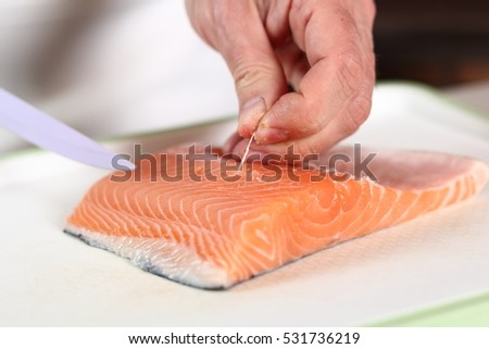 Removing Bones from Salmon Fillet. Making Salmon in Puff Pastry Series.