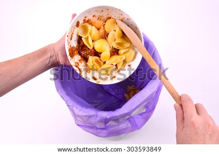 Removing Food from a Porcelin Bowl - stock photo