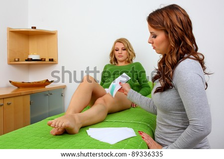 removing hair with wax in professional studio - stock photo