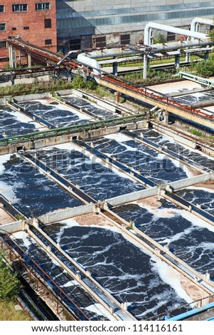 Removing physical, chemical and biological contaminants on sewage treatment plant - stock photo