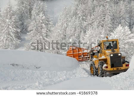 Removing snow from a road in winter