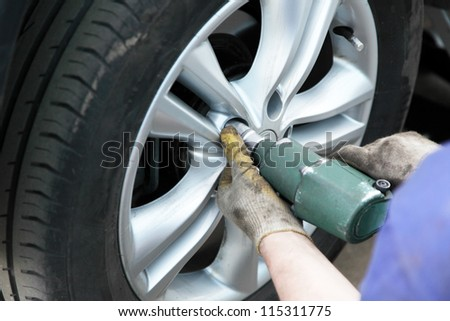 removing the tire of a car to replace the - stock photo