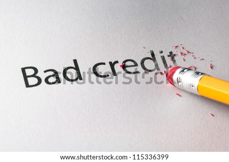 Removing word with pencil's eraser, Erasing Bad Credit - stock photo