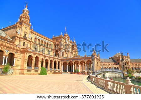 Renaissance building surrounded by sunny esplanade in Plaza de Espana (Spain Square) in Seville, Andalusia, Spain - stock photo