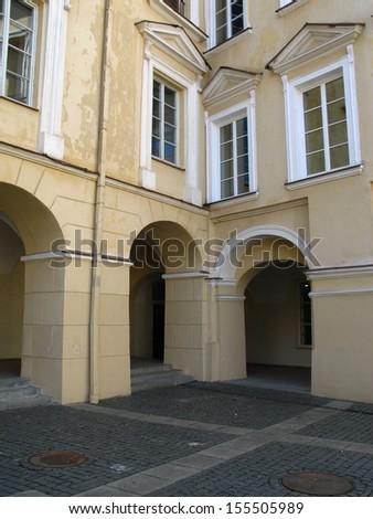 Renaissance courtyard with windows in Vilnius university, Lithuania - stock photo