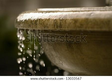 renaissance fountain closeup with waterdrops - stock photo