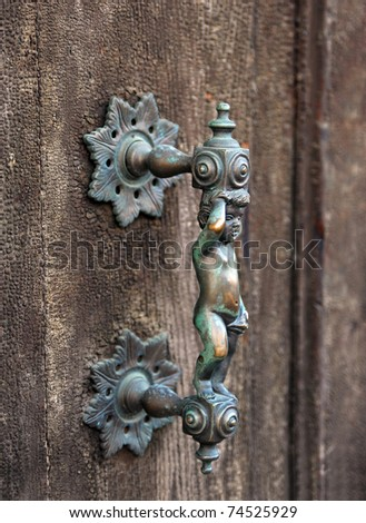 Renaissance handle of door of a  palace in Venice, Italy - stock photo