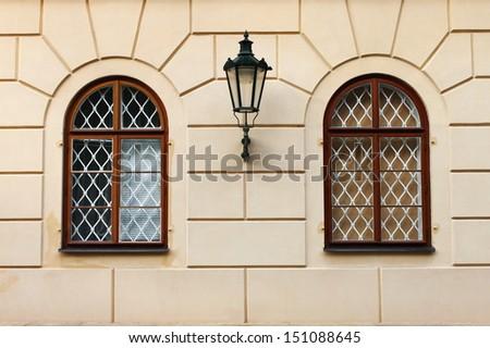 Renaissance windows Renaissance windows with iron street lamp in Prague, Czech Republic - stock photo