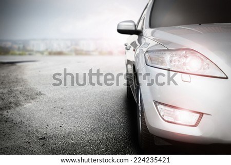 render of silver car without a trade brand in city  - stock photo