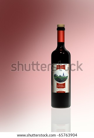 rendering showing a bottle of balsamico vinegar with fictitious label