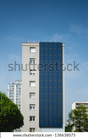 Renewable, alternative solar energy, photovoltaic cell - sun-power plant on a residential building - stock photo