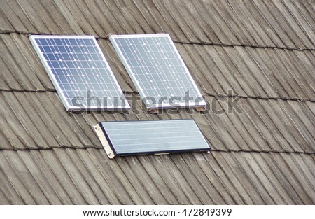 Renewable clean green energy saving efficient solar panels on small 	