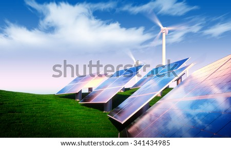 Renewable energy concept - photovoltaic with wind turbines in fresh nature - stock photo