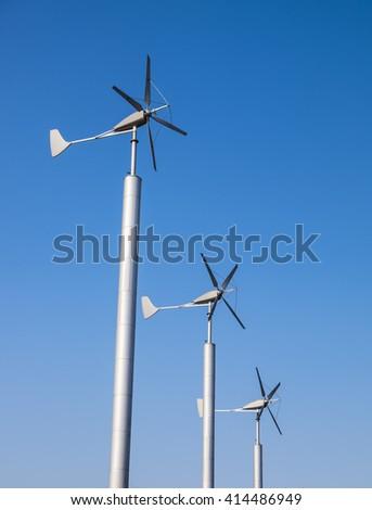 Renewable Energy concept. Wind turbines renewable energy against blue sky at dusk background - stock photo
