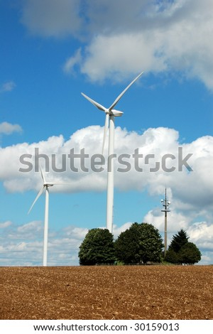 Renewable energy from windmill - stock photo