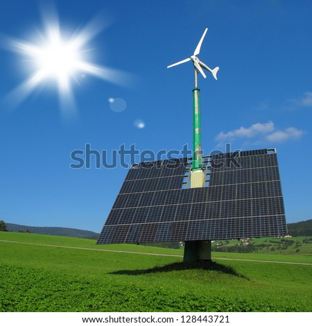 Renewable energy in nature. Solar panels with wind turbine, ecological power plant. - stock photo