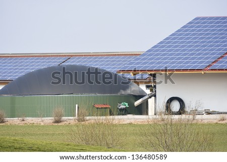 Renewable energy with photovoltaic and a biogas production facility - stock photo